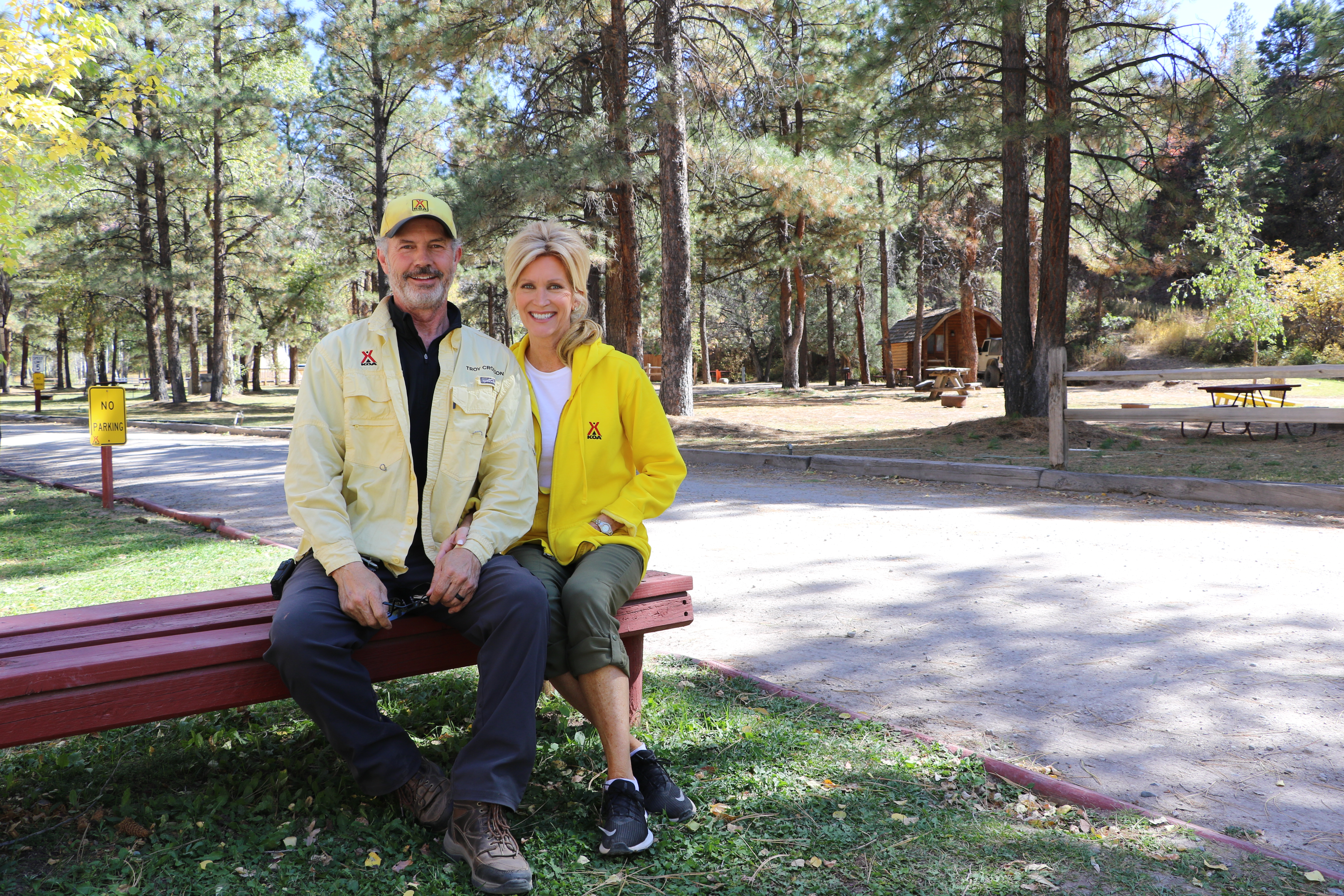 Troy and Penny Crosson, who took over management of the Ouray KOA earlier this month and are scheduled to close on the purchase of the campground in January, will keep the campground open for the winter for the first time in its history in the hope of filling cabins like the one in the background. Plaindealer photo by Erin McIntyre