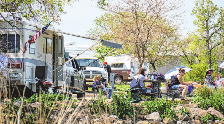Rows of campers, RVs and tents lined the shores of a busyiackson Lake State Park on May 17, 2020. The state park had opened some of its campgrounds earlier in the week after being shut down most of the spring to help curb the spread of coronavirus. Eric Lubbers —The Colorado Sun