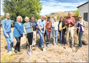 Top, Ridgway Public Library staff and trustees and Friends of the Ridgway Library members break ground on Sept. 26 in a 2,400-square-foot expansion of the facility.