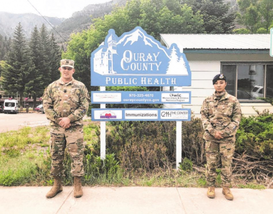 Army National Guard Capt. Daniel Vancil III and Air Force National Guard Tech Sgt. Sydney Krause stand in front of the Ouray County Public Health Agency building, where they've been working to help with COVID-ig issues here. The National Guard members have been stationed here since April to help the community. Liz Teitz — Ouray County Plaindealer