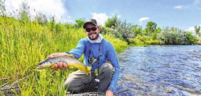 RIGS Fly Shop Guide Service guide Spencer Terry holds a brown trout along the Uncompahgre River. The COVID-19 pandemic has pushed more vacationers outdoors this summer. Courtesy photo