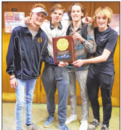 Left to right, Ouray School seniors Judah Preston, Channing Green, Stuart Owens and Liam Miller hold a plaque commemmoriating the Trojans' qualification for the Class 1A boys' basketball state tournament. Alyssa Preston—Special to the Plaindealer