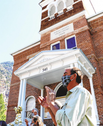 Erin McIntyre — Ouray County Plaindealer Ouray County Commission Chairman Don Batchelder applauds at the dedication ceremony for the renovated courthouse, held in September. COVID-19 delayed the celebration from the original plans to hold it in July.