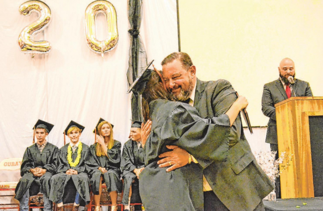 "Ouray School District Superintendent Scott Pankow hugs a high school graduate during last year's graduation ceremony. The Ouray School Board voted unanimously on Monday to fire Pankow after a decade on the job, months after placing him on an improvement plan that cited a need for a ""culture change"" at the school and an improved relationship between administration and staff. Erin McIntyre — Ouray County Plaindealer"