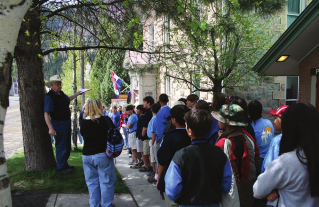 Walt Rule leads a tour in front of the Ouray County Museum. One of the founders of the Ouray County Historical Society in 1971 who helped achieve National Historic District status for the city of Ouray, Rule died on April 18. Photo courtesy Ouray County Historical Society