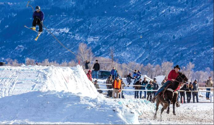 Photo courtesy Mark LaRowe: Richard Weber III pulls skier Tyler Smedsrud of Ridgway during a previous skijoring competition. The event this weekend brings skiers and snowboarders to compete with riders on a course built at the fairgrounds, including a gap where pros can jump over a Toyota truck, lengthwise. A new Jumbotron will provide up-close action for viewers.