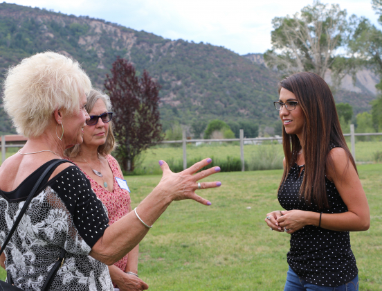 Congressional candidate Lauren Boebert talks with supporters after her speech on Saturday in Ouray County.