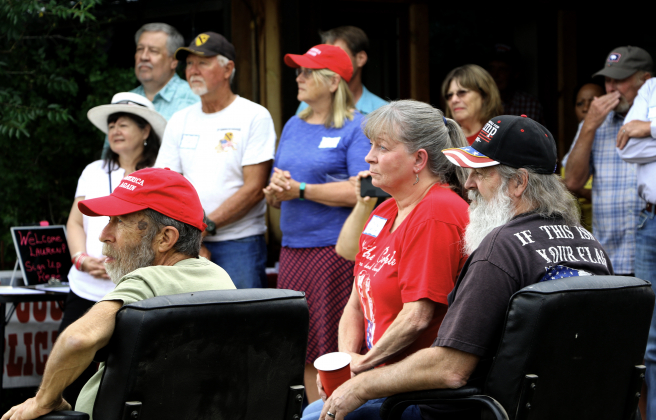 Attendees of Lauren Boebert's meet-and-greet on Saturday at the Orvis Ranch listen to the candidate for 3rd Congressional District. More than 100 people attended.