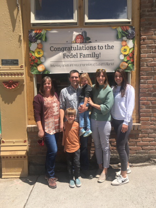 Christen (Duckett) Williams, left, signed over ownership of Duckett's Market to Tom and Alyssa Fedel last Friday. Kayla Fairchild, Williams' daughter, (far right) will help with the transition. The Fedel children Atticus (standing) and El iana will be the fifth generation of Fedels to attend Ouray School. Carolina Brown — Ouray County Plaindealer
