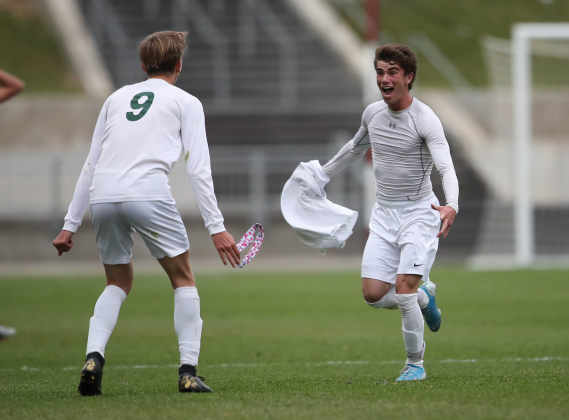 Ridgway senior midfielder Robert Beserra, right, celebrates his game-winning goal with junior Christian Lindler during the Class 2A boys' soccer championship match on Nov. 16 at Dick's Sporting Goods Park in Commerce City. Beserra's goal with 37 seconds left gave the Demons a 2-1 victory over Dawson School — and its first state soccer title. Photo courtesy Tim Bourke