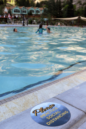 Families enjoy the pool in small, distanced groups on Tuesday night, adhering to the rules at the Ouray Hot Springs Pool. Erin McIntyre — Ouray County Plaindealer