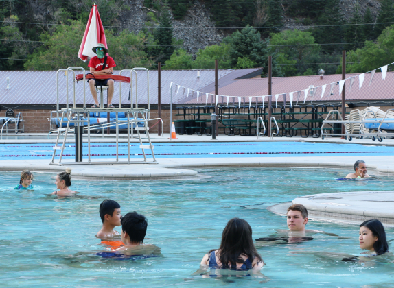 A lifeguard watches sparse groups of distanced swimmers in the Ouray Hot Springs Pool on Tuesday evening.The pool, which normally has a maximum capacity of just under 800, is limited to 5o swimmers at a time due to state health orders. Efforts to obtain a variance to allow more swimmers have not been successful so far.