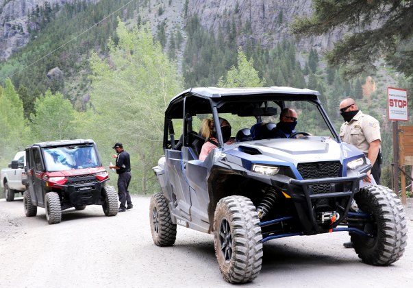 Ouray County Sheriff Justin Perry and Ouray Police Chief Jeff Wood intercept drivers headed up County Road 361 near Senator Gulch on Monday. The officials have started a public education campaign to talk with drivers about trails etiquette after increased conflicts, accidents and damage on high country roads, which are experiencing more visitation. Perry attributes the popularity to COVID-19 and people wanting to get outside. Photo by Erin McIntyre