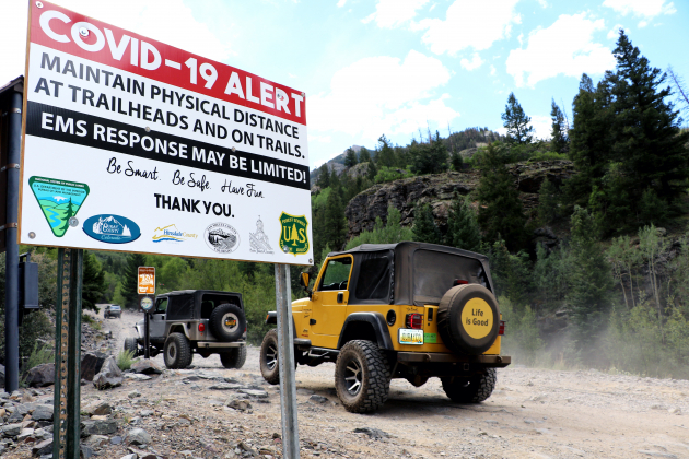 """A Jeep with a """"OURAYCO"""" vanity license plate from Michigan waits to head up Engineer Pass south of Ouray. Local law enforcement officials have noticed more accidents, more visitation and more conflict on high country roads between users who aren't used to trail etiquette. Traffic counts on the bridge below this turnoff, at the Ice Park, show roughly 40 percent more traffic along the route in July, compared to July 2019. Photo by Erin McIntyre"""