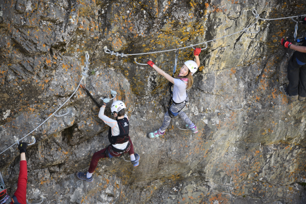 Mason Disser, left, and Charlotte Vanderploeg, both of Ouray, navigate a section of the Ouray Via Ferrata this week. Photo by Mark Iuppenlatz.