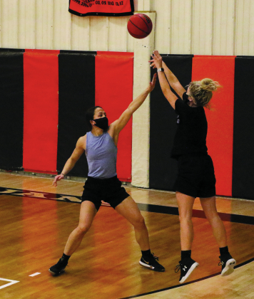 The Ouray girls basketball team practices for the first time this season with masks on Monday.