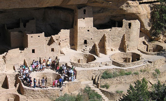 Visitors tour the Cliff Palace at Mesa Verde National Park. Photo courtesy National Park Service.