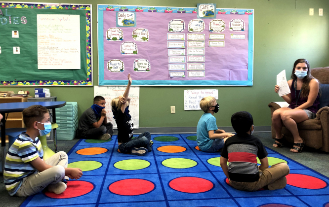 Kelly Sampson teaches a phonics lesson to first and second graders at Ridgway's summer school, who must wear masks and try to maintain some social distancing inside the classroom. About 35 students are in summer school in Ridgway, where teachers are getting a preview of how coronavirus precautions will play out when classes resume this fall.